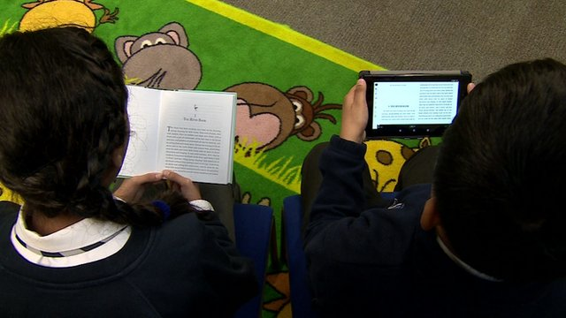 Children reading books and e-books
