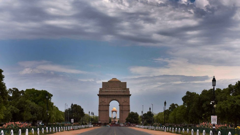 Clouds hover over the blue sky at India Gate during the lockdown to limit the coronavirus on April 20, 2020 in New Delhi, India.