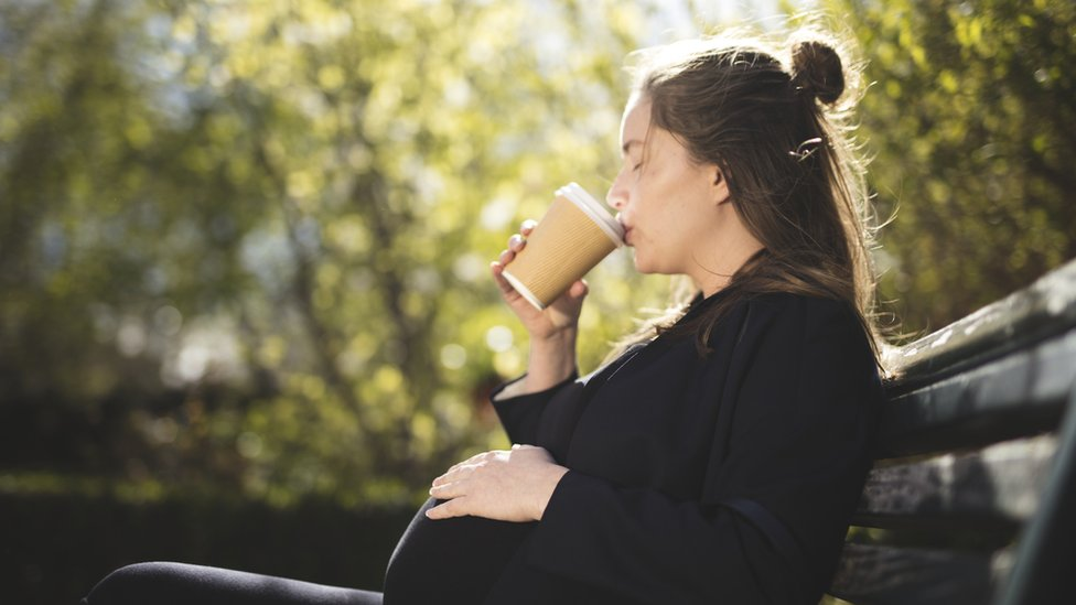 pregnant woman drinking coffee