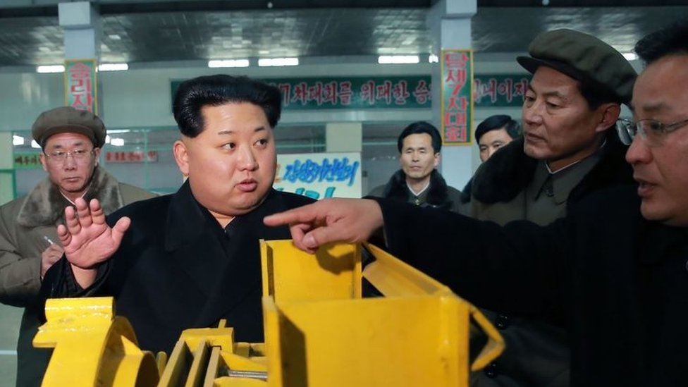 North Korean leader Kim Jong-Un (second left) visiting the Thaesong machine factory in Nampo