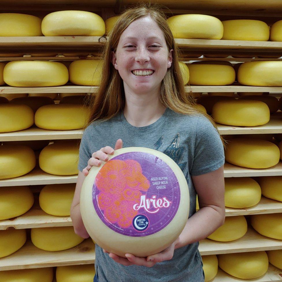 Avery Jones holding her award-winning cheese