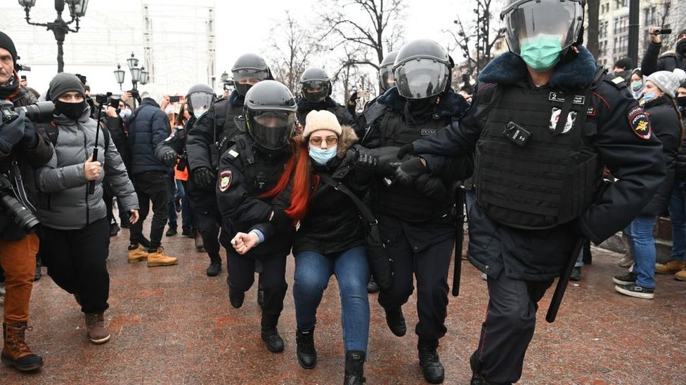 Police detain a woman during a rally in support of jailed opposition leader Alexei Navalny in downtown Moscow on January 23, 2021