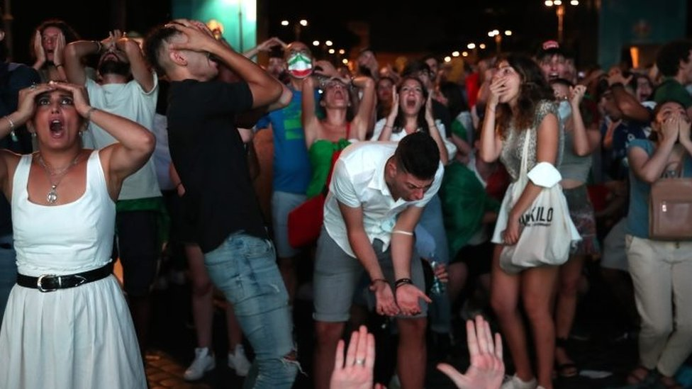 Italian football fans in Rome react during the Italy-England Euro 2020 final in London. Photo: 11 July 2021