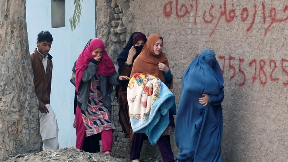 Residents flee the area amid the attack