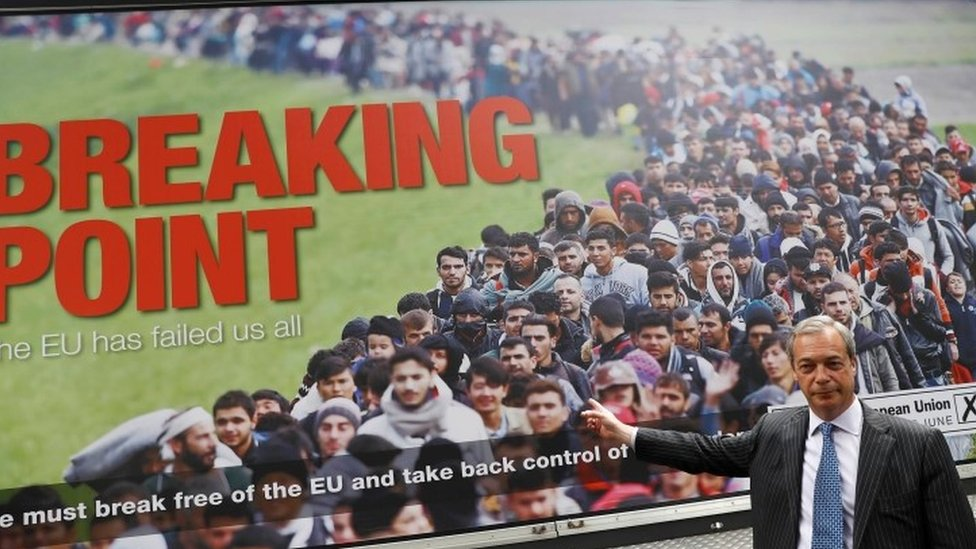 Nigel Farage standing in front of poster during EU referendum