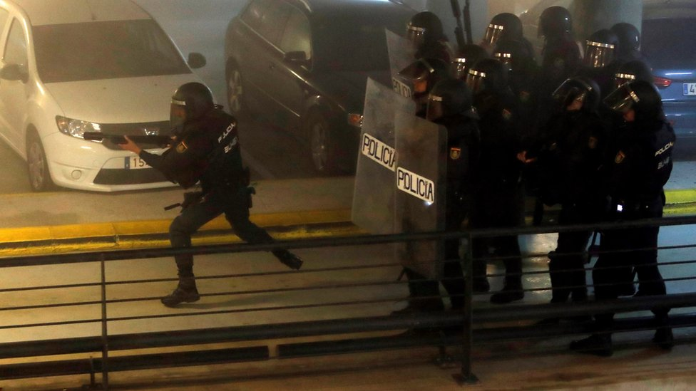 """Spanish National Police riot officers charge at demonstrators during the rally called by the group called """"Tsunami Democratic"""" (Democratic Tsunami) for """"shutting-down"""" Barcelona-El Prat international airport"""