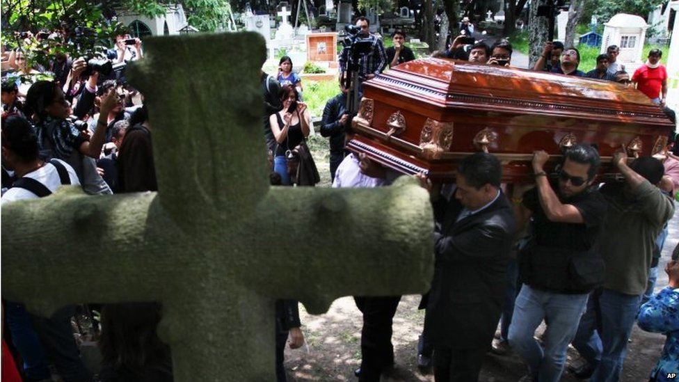 Men carry the casket of murdered photojournalist Ruben Espinosa during his funeral service in Mexico City on 3 August, 2015.