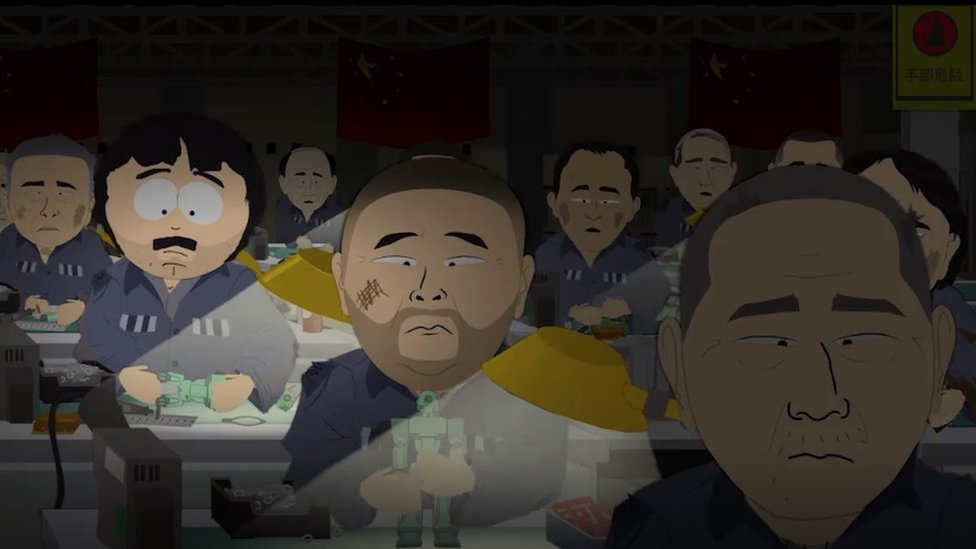 Randy (left, with moustache) making toys in a Chinese prison