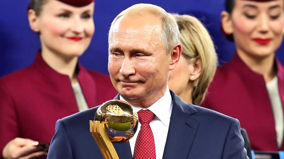 President of Russia Vladimir Putin looks on holding the player of the tournament award after the 2018 FIFA World Cup Russia Final on 15 July 2018
