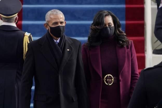 Barack Obama dan istri Michelle Obama hadir dalam acara pelantikan presiden di gedung Capitol.