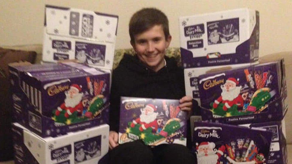 Paisley boy gives 100 selection boxes to food bank