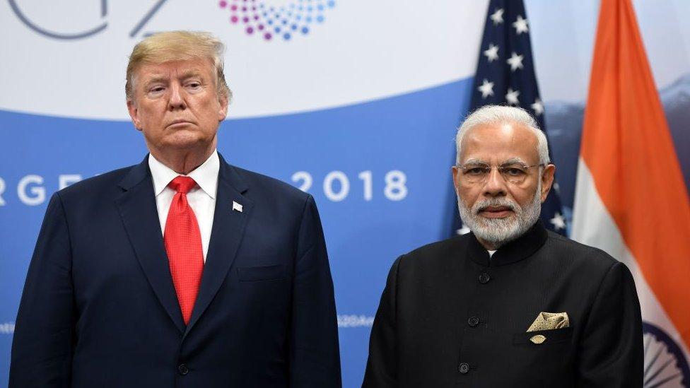 India's Prime Minister Narendra Modi (R) and US President Donald Trump