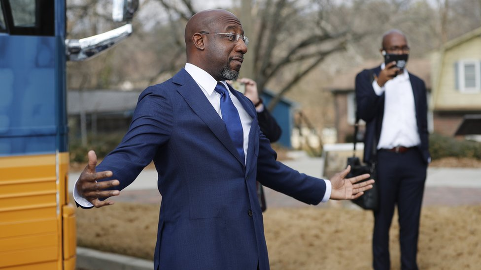 Democratic Senate candidate Rev. Raphael Warnock speaks outside his campaign