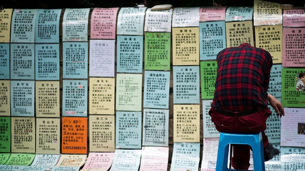 """Worried parents place advertising notices for their single children at a """"marriage market"""" in Shanghai"""