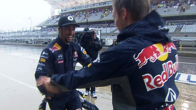 Red Bull's Daniel Ricciardo and Daniil Kvyat dance in the pit lane
