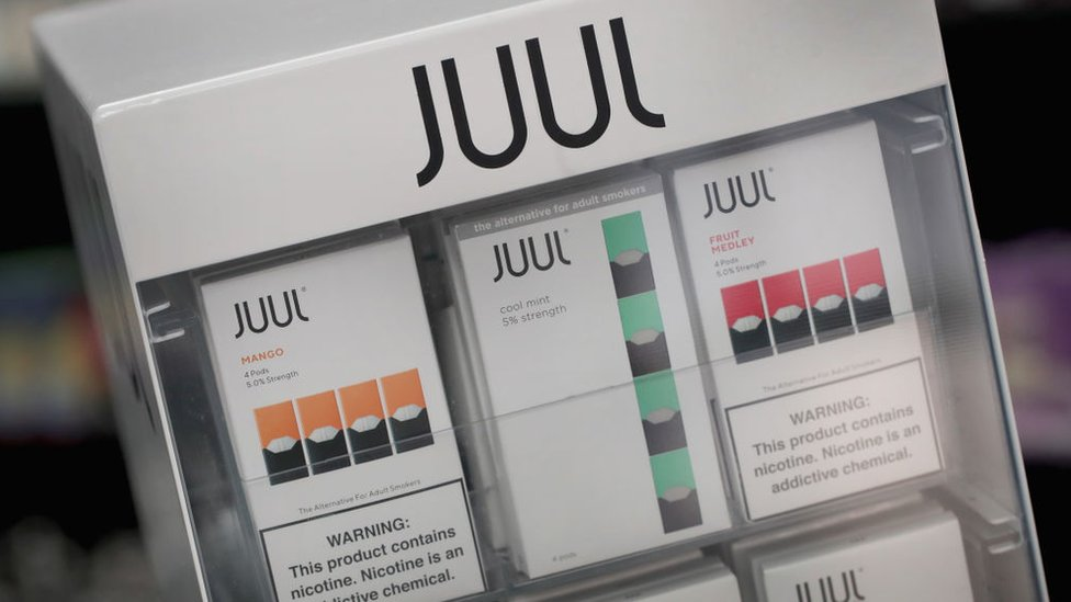 Electronic cigarettes and pods by Juul, the nation's largest maker of vaping products, are offered for sale