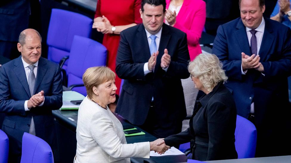Chancellor Merkel in Bundestag, congratulating new justice minister, 27 Jun 19
