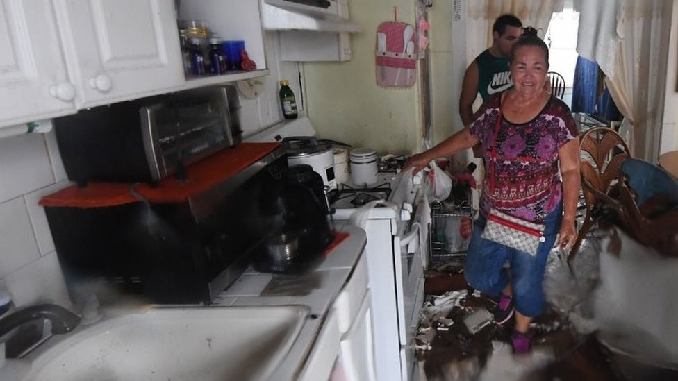 Celina Martinez returns to find their family home badly damaged after Hurricane Harvey hit Rockport (26 August 2017)