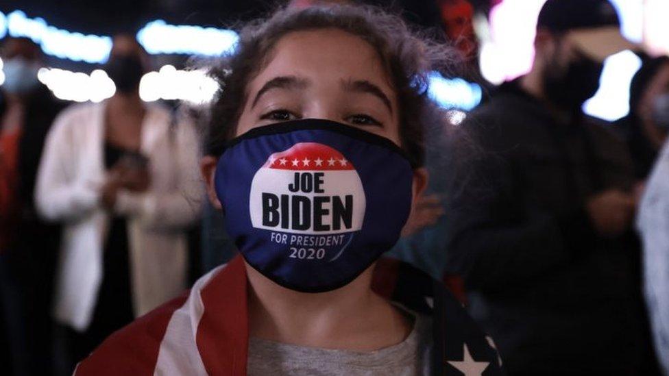 Biden supporter Elise, nine, in New York