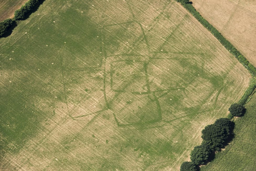 Parch marks of a Roman farm in a field of grass at Bicton, Devon