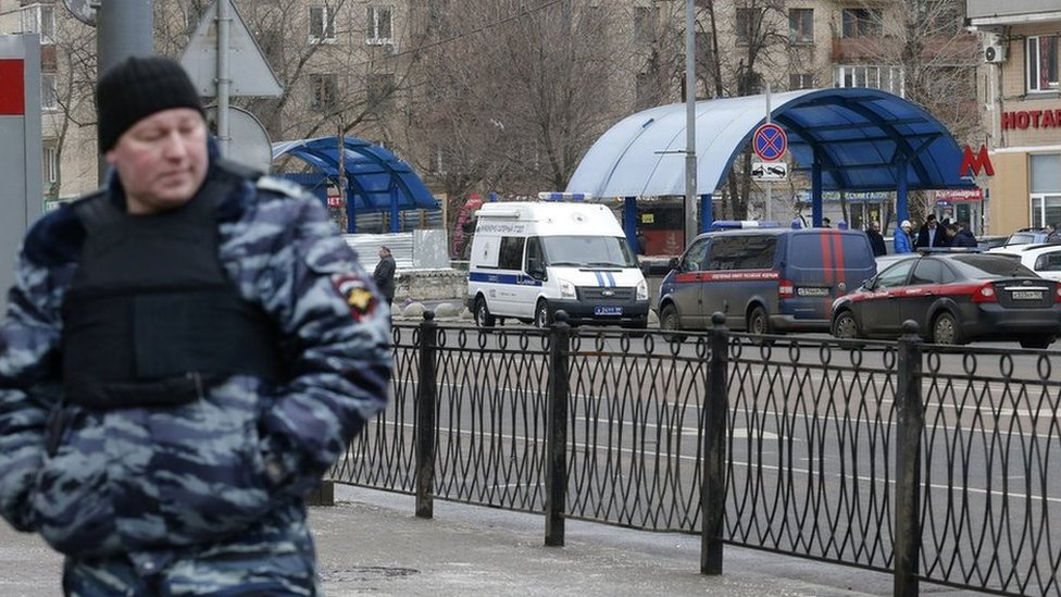 A policeman stands guards near the Moscow metro station where the beheading suspect was arrested, 29 February