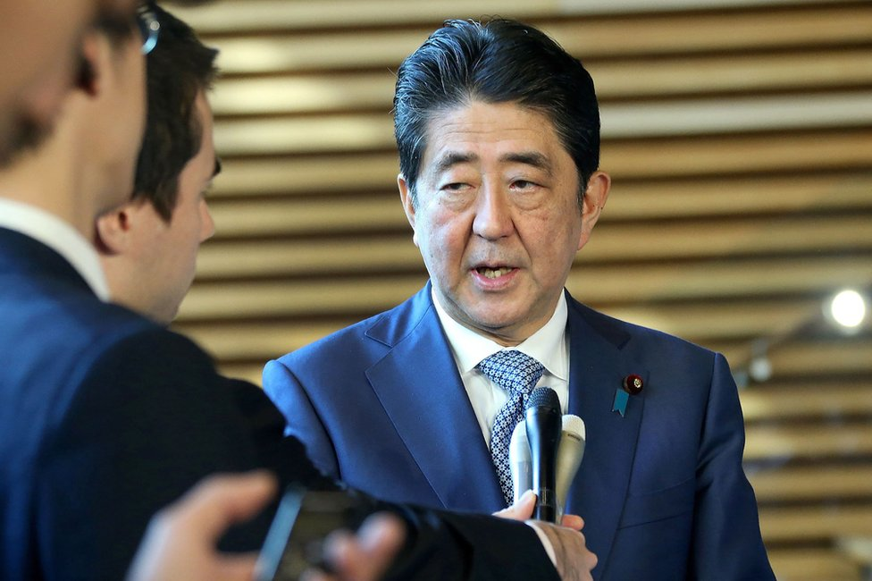 Japanese Prime Minister Shinzo Abe answers questions after talking by phone to US President Donald Trump at his official residence in Tokyo, 29 November