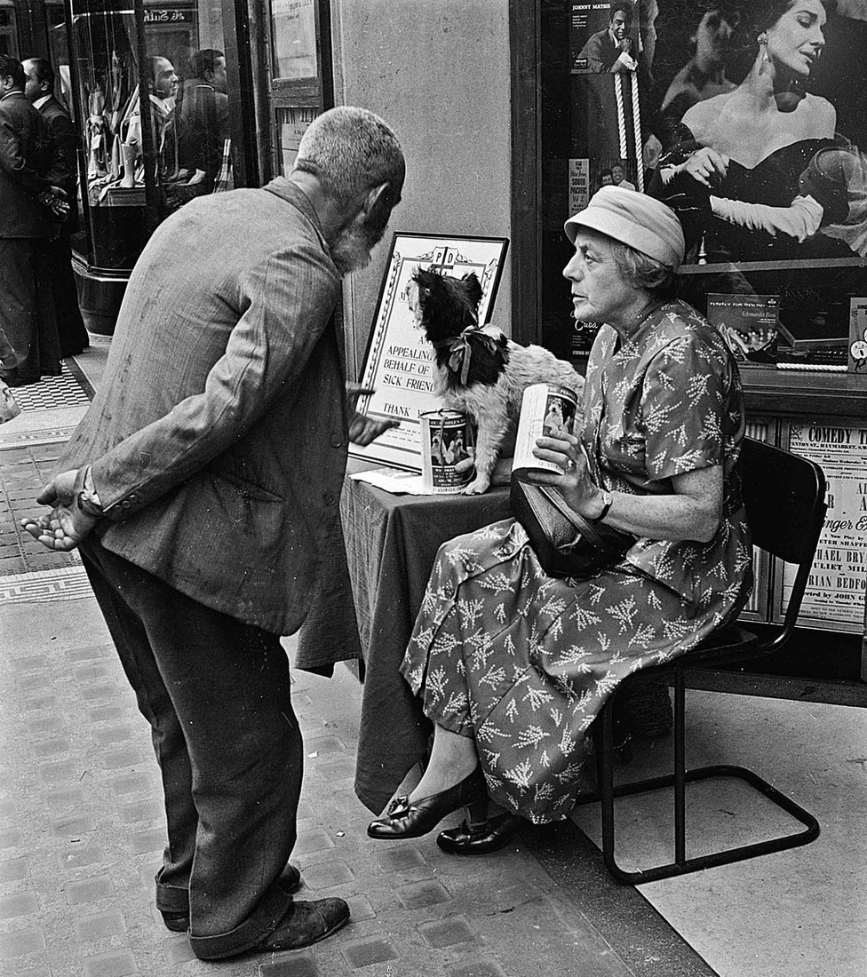 Woman collecting for the PDSA charity, Regent St, London 1955