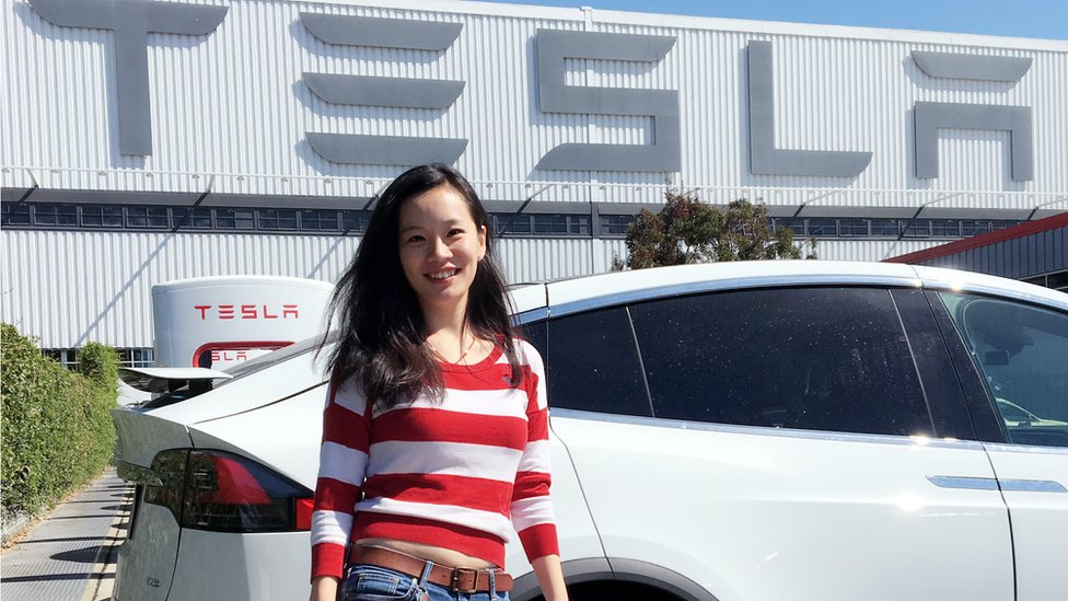 Han Zhu at the Tesla dealership