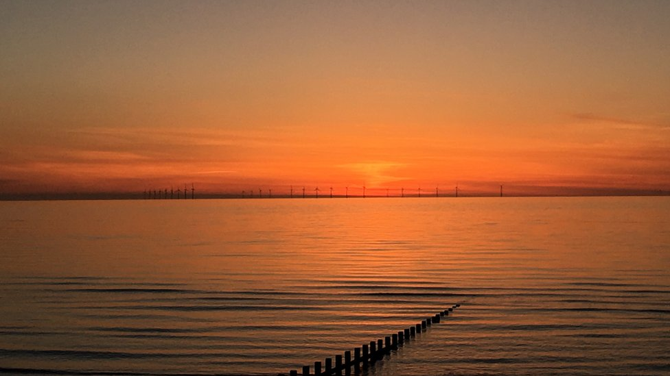 Sunset over the offshore wind farm off Rhyl, courtesy of Natalie Clements