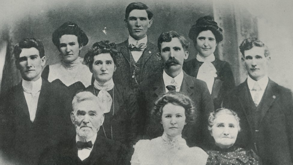 A portrait of John LW Evans and his family