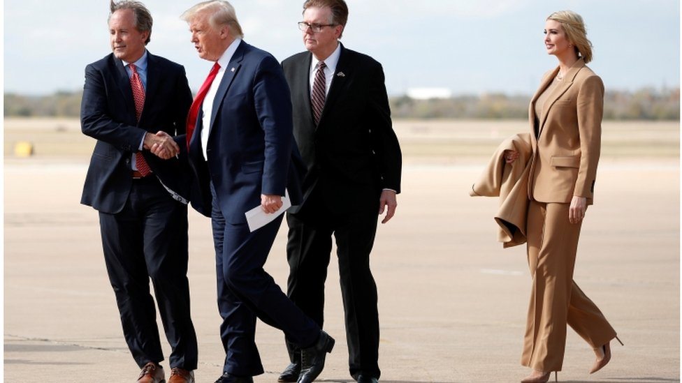 President Donald Trump and Ivanka Trump are greeted by Texas Lt. Governor Dan Patrick and Attorney General Ken Paxton