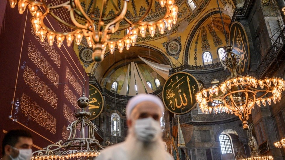 Christian mosaics and frescoes in Hagia Sophia's semi-domes were covered with white drapes