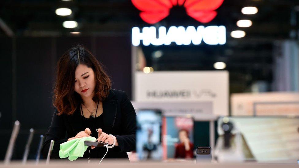 Woman polishes Huawei phone