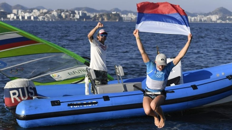 Russia's Stefaniya Elfutina celebrates after competing in the RS:X Women sailing race on Guanabara Bay in Rio de Janerio during the Rio 2016 Olympic Games on August 14, 2016