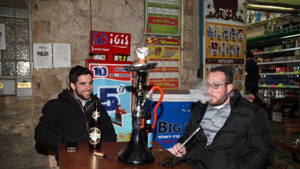 Men smoking in Jerusalem pub