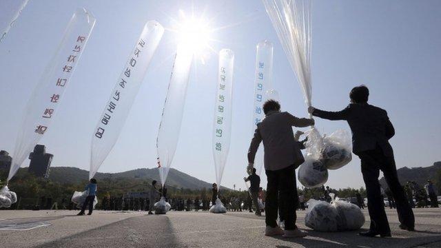 South Korean activists hold a balloon containing anti-North Korea leaflets