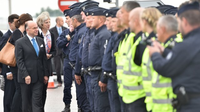 Theresa May inspecting security in Calais