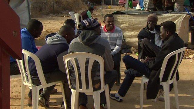 Group of men sitting