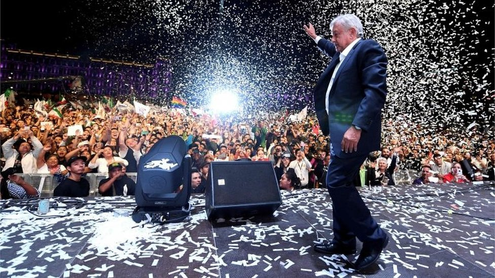 Newly elected President Andres Manuel Lopez Obrador cheers his supporters at the Zocalo Square after winning general elections, in Mexico City, on July 1, 2018