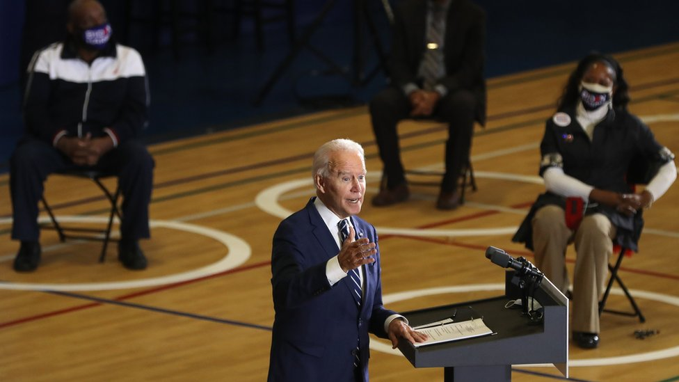 Biden holds a social distance rally in Michigan