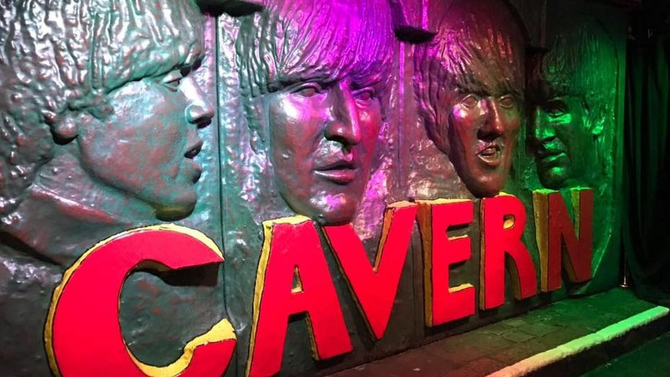 Sculpted wall tribute to the Beatles on a wall in the Cavern Club