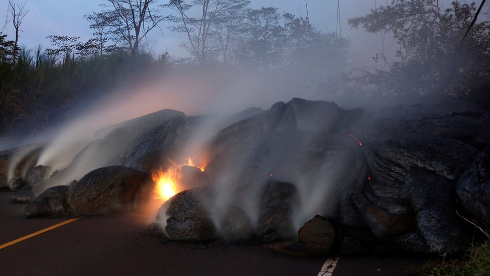Volcanic gases rise from the Kilauea lava flow that crossed Pohoiki Road near Highway 132, near Pahoa, Hawaii, US on 28 May 2018