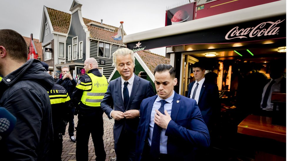 Dutch member of Parliament and leader of the far-right Party for Freedom (PVV) Geert Wilders (C) visits Volendam on 3 March