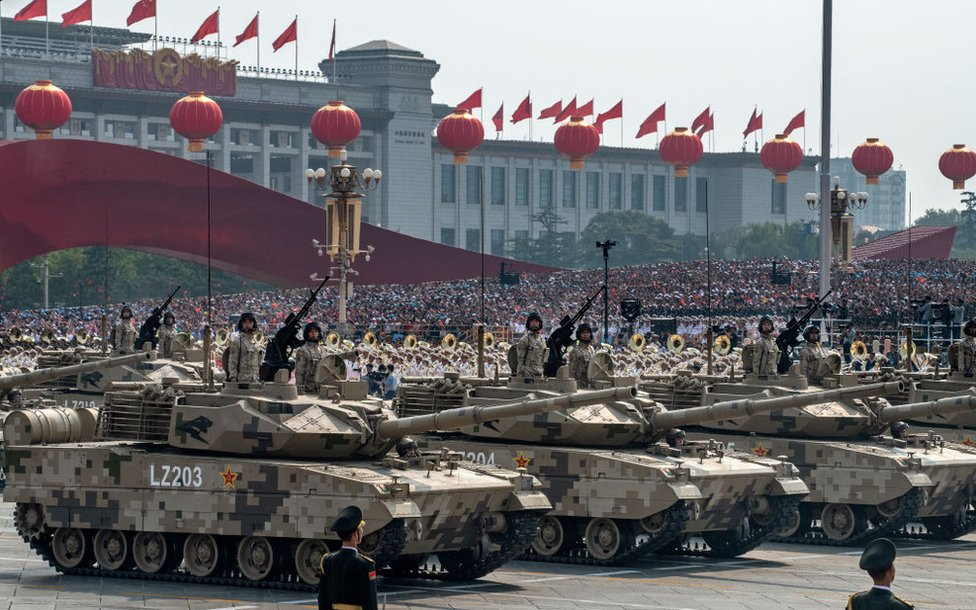 Chinese soldiers atop tanks in a parade to celebrate the 70th anniversary of the founding of the People's Republic of China in 1949, at Tiananmen Square in Beijing on 1 October 2019.