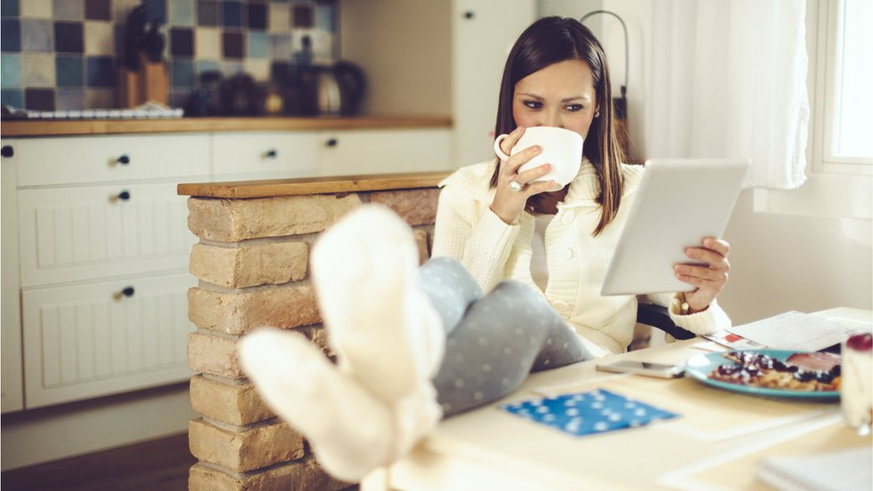 woman relaxing using tablet