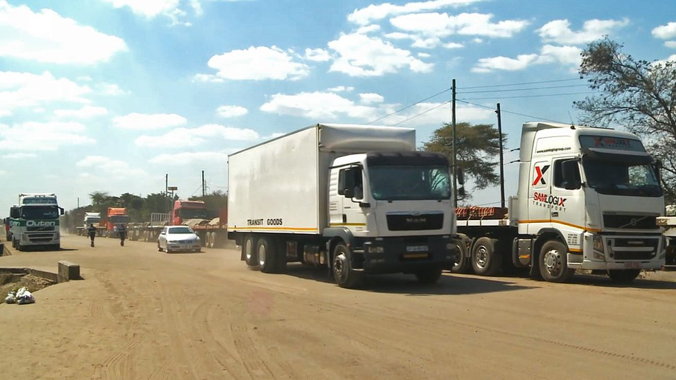 Convoys of trucks queuing outside a border post in Zambia
