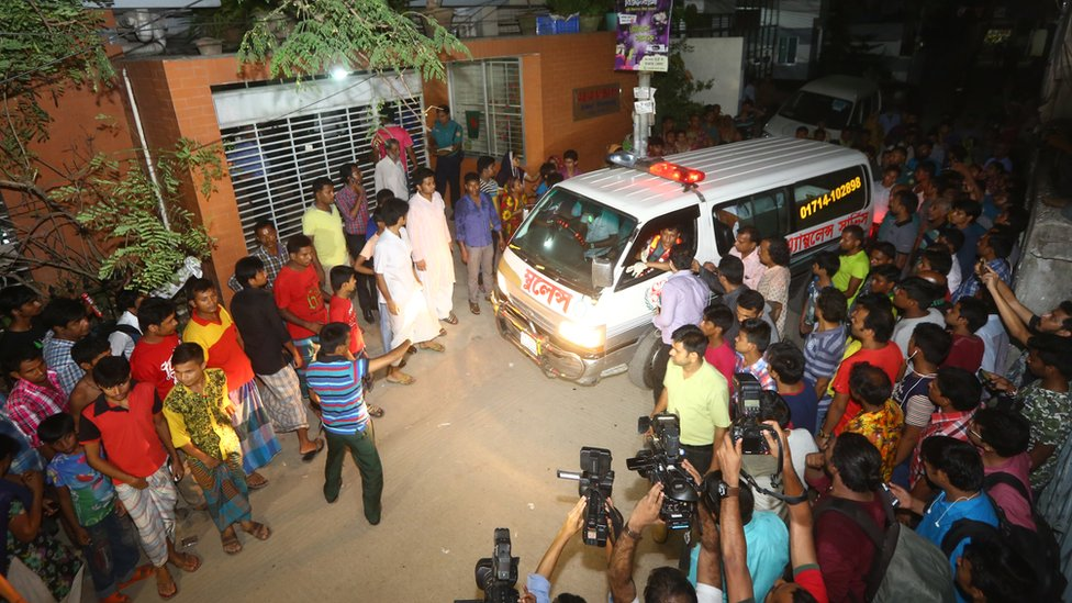 The bodies of two gay rights activists who were hacked to death are brought down from an apartment in Dhaka on April 25, 2016.