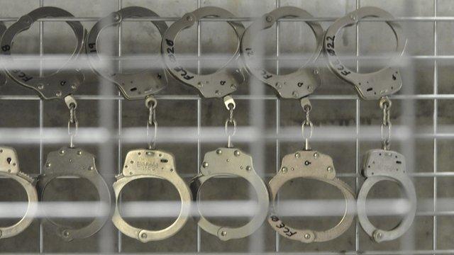 Handcuffs on bars