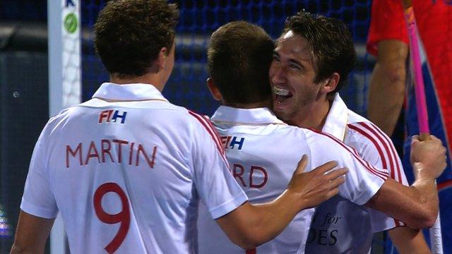 David Condon celebrates with England team-mates at EuroHockey 2015