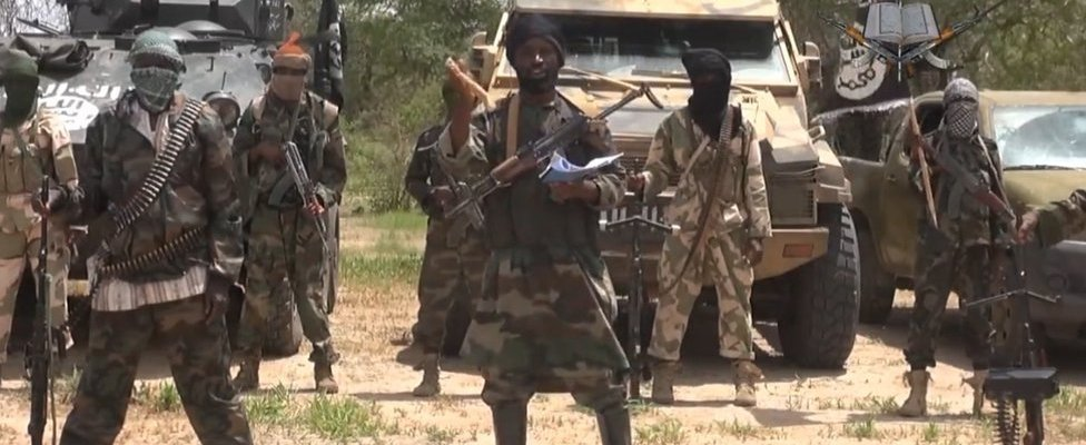 A screengrab taken on 13 July 2014 from a video released by the Nigerian Islamist extremist group Boko Haram and obtained by AFP shows the leader of the Nigerian Islamist extremist group Boko Haram, Abubakar Shekau (C).